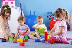 infant kids playing lego