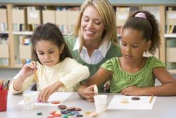 teacher teaching her students to write