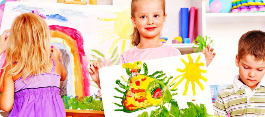 girl showing some of her artworks
